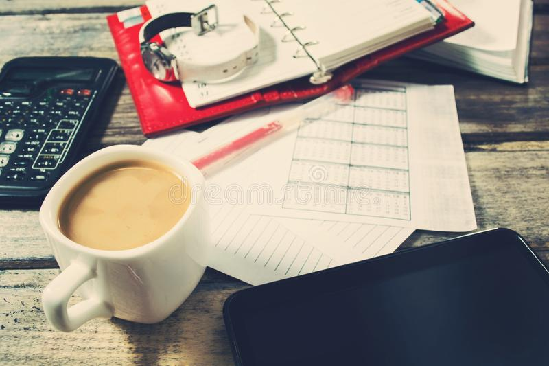 Business concept with coffee and notebook over wooden background stock photo