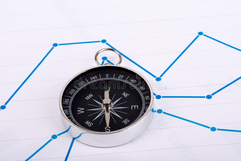 Business concept with compass and graph on paper.  stock photography