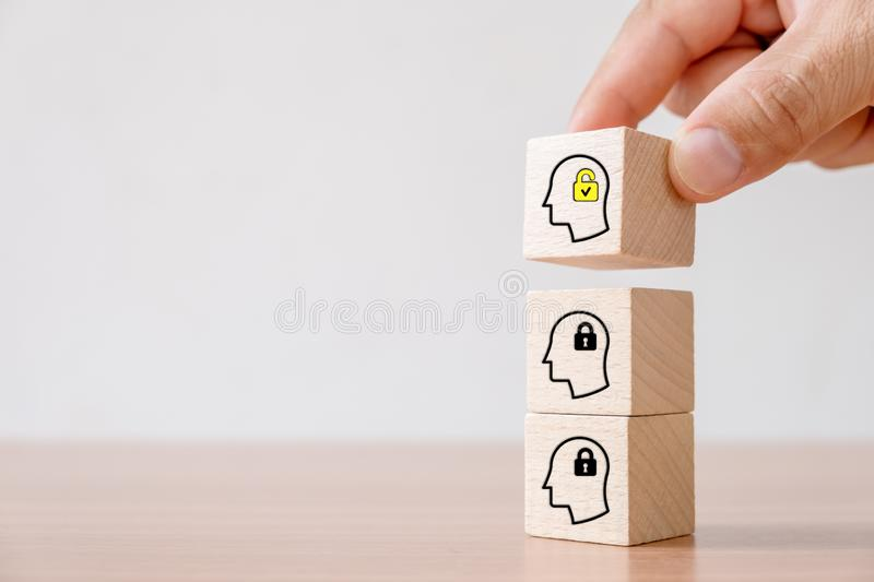 Business concept of creative idea and innovation. Hand picked wooden cube block with unlock icon new idea and head human symbol have lock idea royalty free stock image
