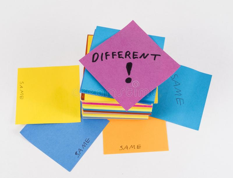 Business concept: different ideas inspire 3. Images using sticky notes of various colors on a white tabletop setup show the concept of different ideas rising royalty free stock photo