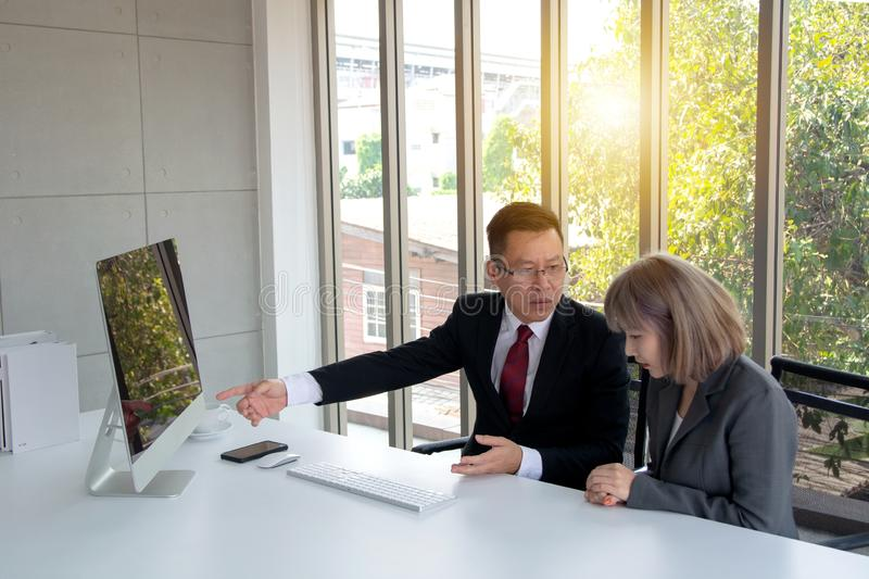 Business concept of discussing problem with disappointed look showing to his secretary the serious issue royalty free stock images