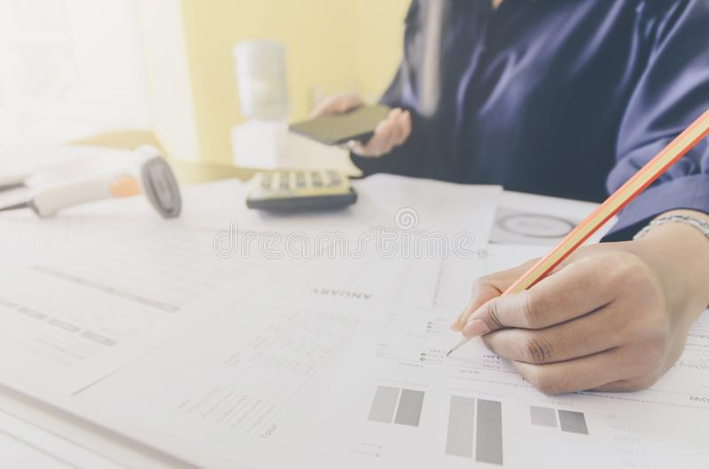 Business concept of financial and accounting with paper sheet of planning data. Business concept of financial and accounting with human hand are holding stock images