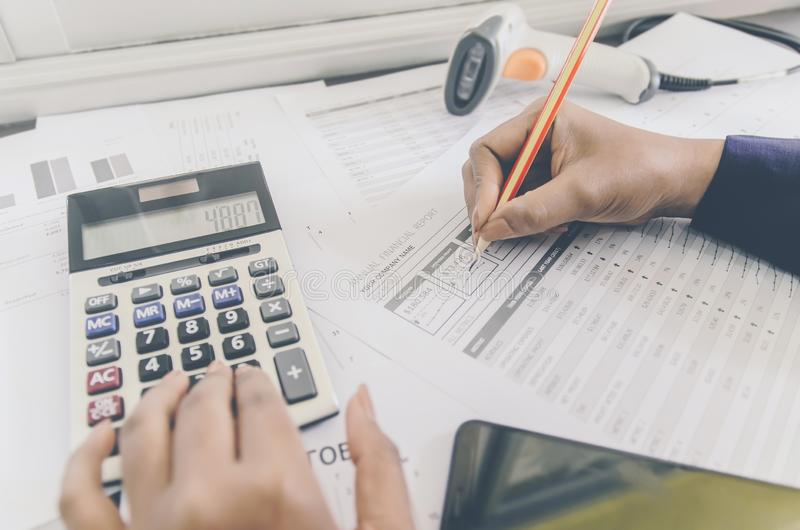 Business concept of financial and accounting with paper sheet of planning data. Business concept of financial and accounting with human hand are pointing on royalty free stock images