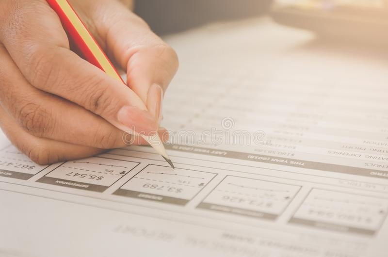 Business concept of financial and accounting with paper sheet of planning data. Business concept of financial and accounting with human hand are pointing on stock images