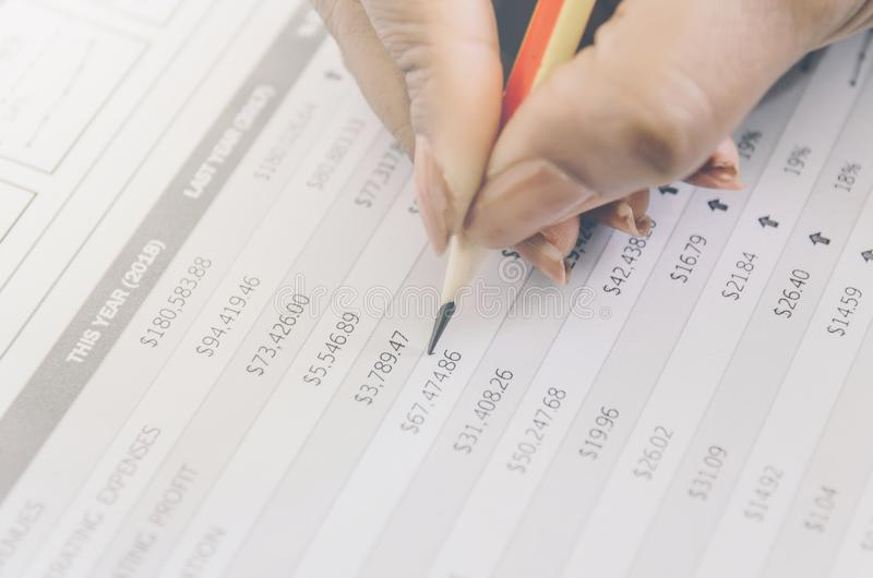 Business concept of financial and accounting with paper sheet of planning data. Business concept of financial and accounting with human hand are pointing on stock image