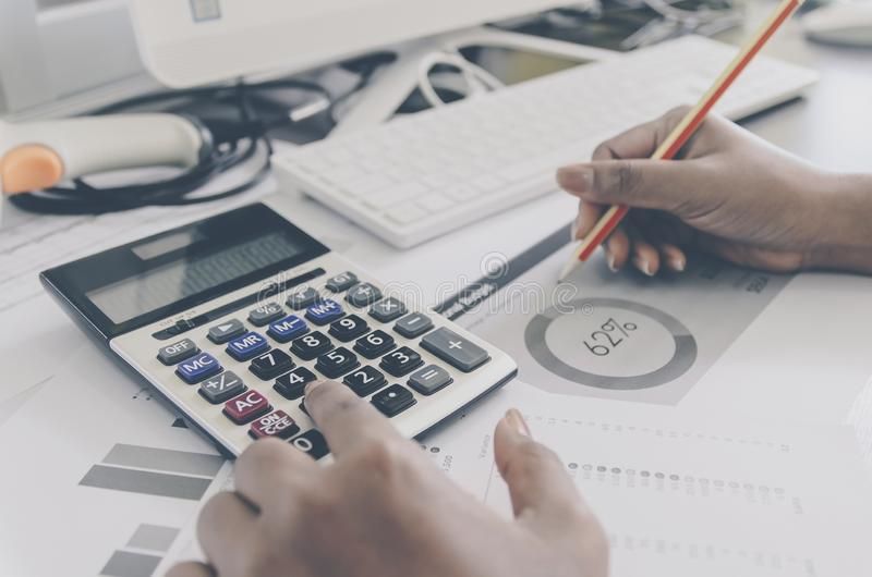 Business concept of financial and accounting with paper sheet of planning data. Business concept of financial and accounting with human hand are pointing on stock photo