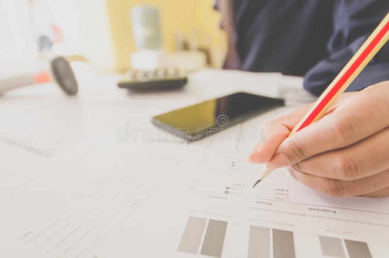 Business concept of financial and accounting with paper sheet of planning data. Business concept of financial and accounting with human hand are pointing on royalty free stock photo