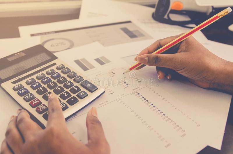 Business concept of financial and accounting with paper sheet of planning data. Business concept of financial and accounting with human hand are pointing on stock photos