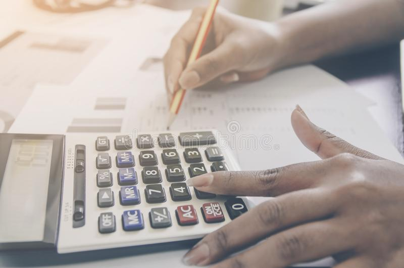 Business concept of financial and accounting with paper sheet of planning data. Business concept of financial and accounting with human hand are pointing on stock photography