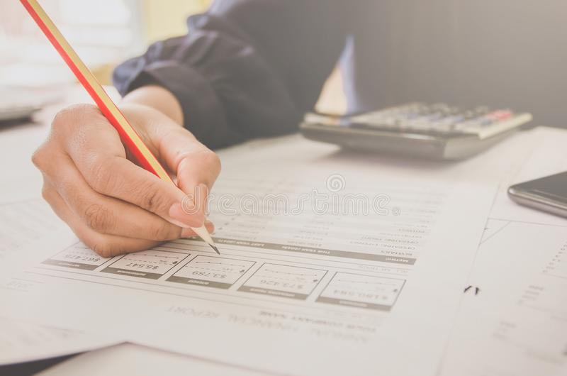 Business concept of financial and accounting with paper sheet of planning data. Business concept of financial and accounting with human hand are pointing on royalty free stock image