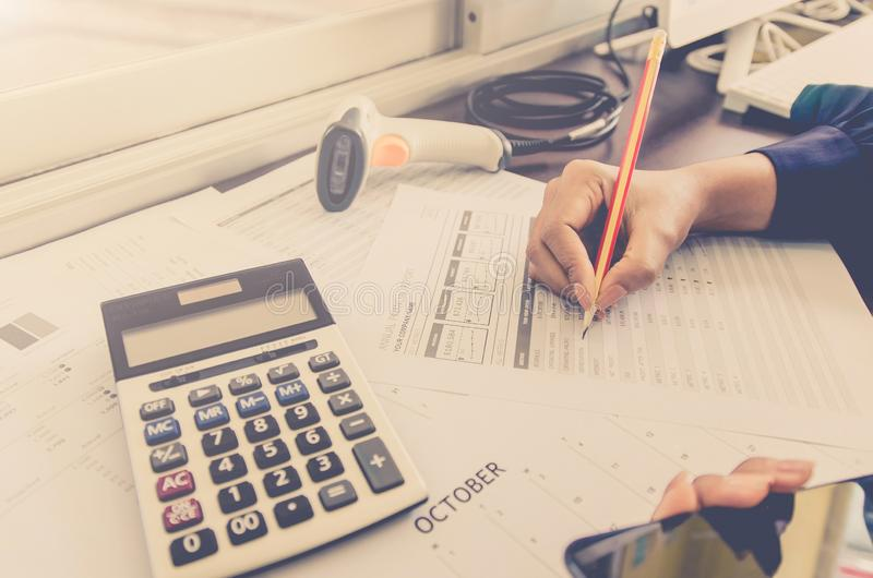 Business concept of financial and accounting with paper sheet of planning data. Business concept of financial and accounting with human hand are pointing on royalty free stock photography