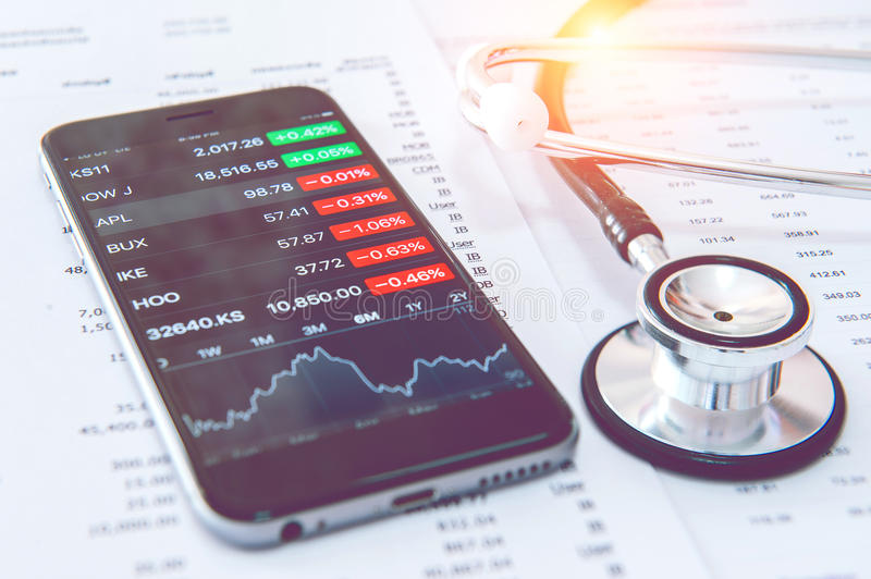 Business concept. Financial analysis, Smartphone and Stethoscope stock photography