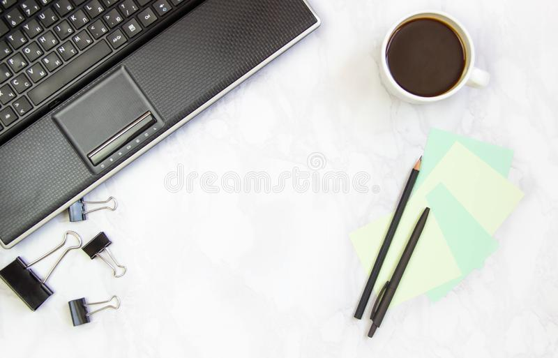 Business concept frame with laptop on a marble background. Workplace view from above. Copy space.  stock photography