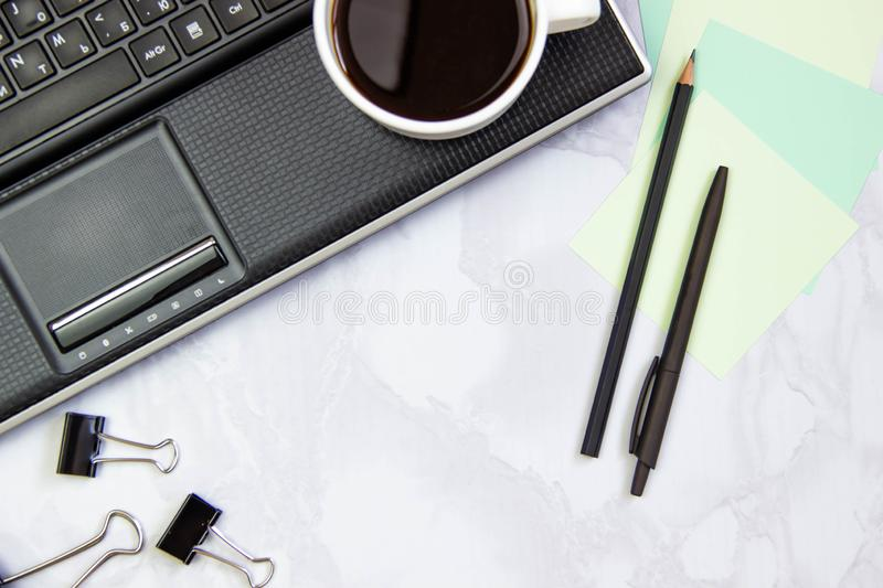 Business concept frame with laptop on a marble background. Workplace view from above. Copy space.  stock image