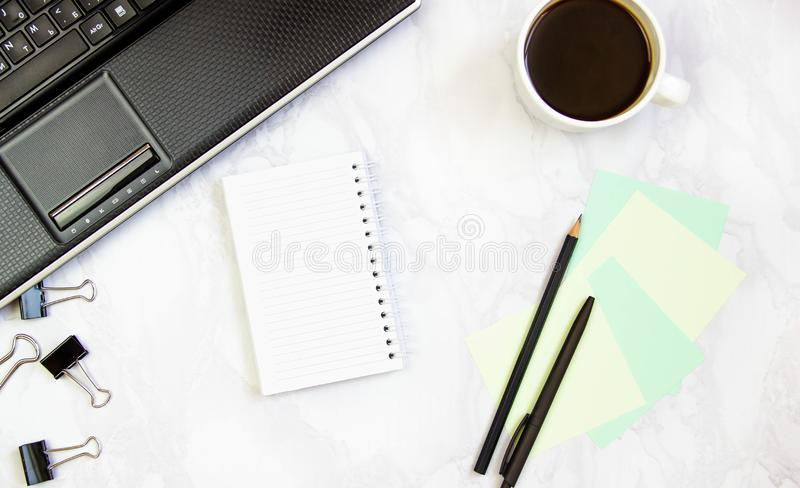 Business concept frame with laptop on a marble background. Workplace view from above. Copy space.  royalty free stock image