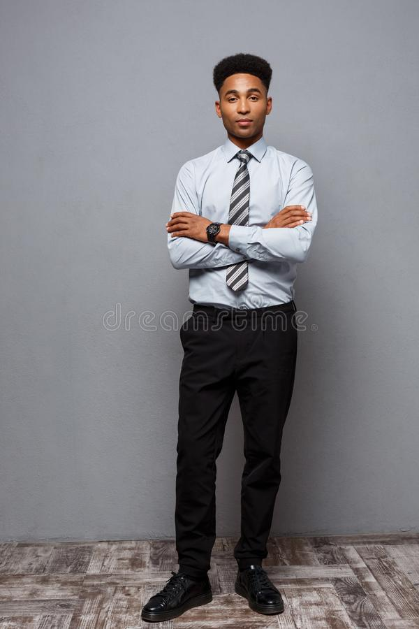 Business Concept - Full length portrait of confident african american businessman in the office. stock photo