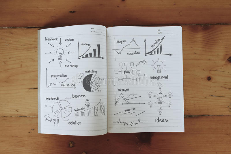 Business concept and graph drawing on book stock illustration