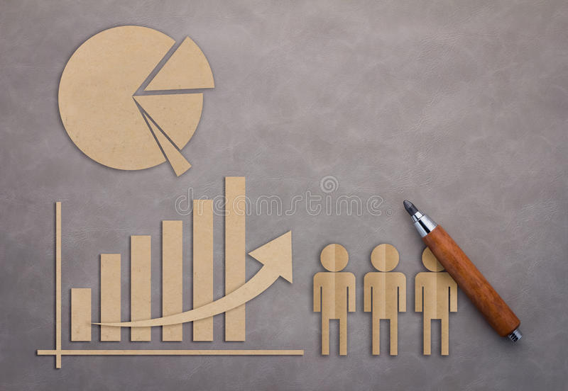 Business concept with graph and pie chart paper cut stock photography