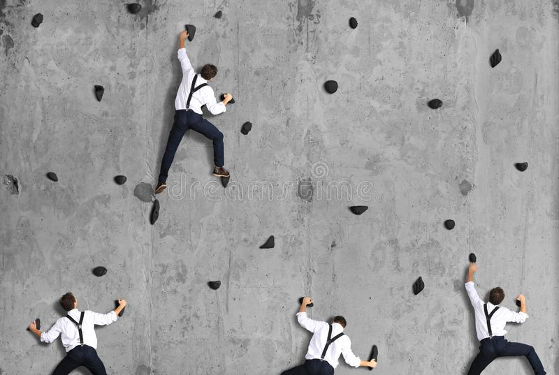 Business concept, a group of employees climbs stock image
