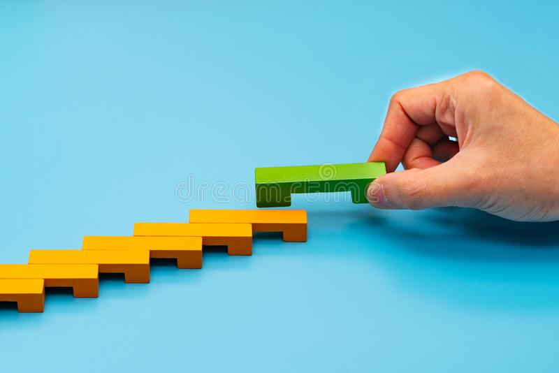 Business concept for growth success process, hand stacking wood block as step stair stock photos