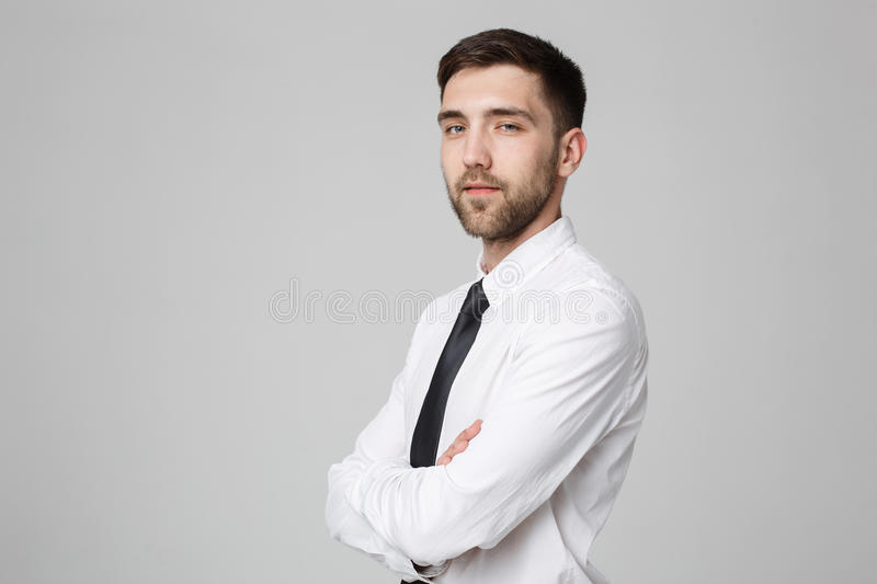 Business Concept - Handsome Business man crossed arms with confident face. White Background. royalty free stock images