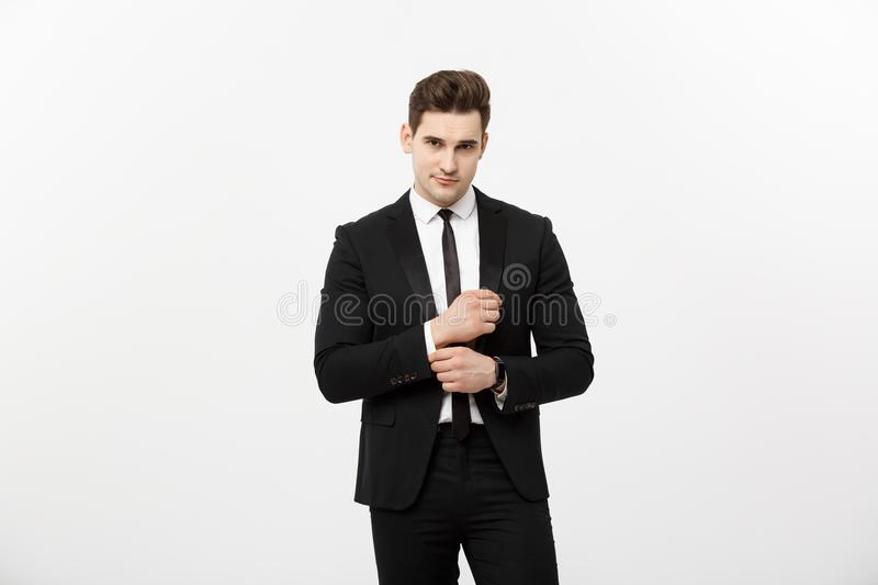 Business Concept: Handsome Man Happy Smile Young Handsome Guy in smart suit posing over Grey Background. Business Concept: Handsome Man Happy Smile Young stock photo