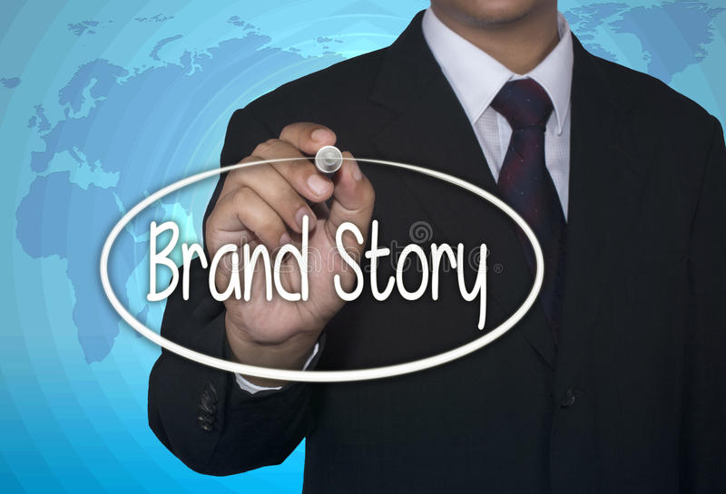 Business concept handwriting marker and write Brand Story. Over light blue background with world map royalty free stock photo