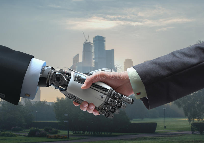 Business concept of Human and robot hands with handshake. Human and robot handshake Cybernetic Futuristic business relationship symbol royalty free stock images
