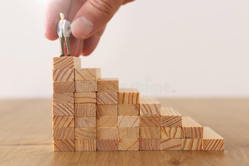 Business concept image of challenge. A man over a high wall. Problem solving and decision making.  stock photos