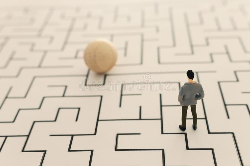 Business concept image of and challenge. A man stands in the maze looking for the exit. Problem solving and decision making idea.  stock image