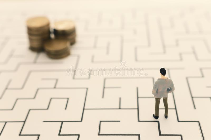 Business concept image of and challenge. A man stands in the maze looking for the exit. Problem solving and decision making idea.  royalty free stock photos