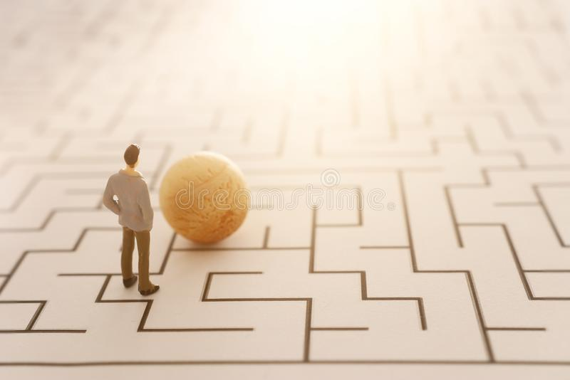 Business concept image of and challenge. A man stands in the maze looking for the exit. Problem solving and decision making idea.  royalty free stock image