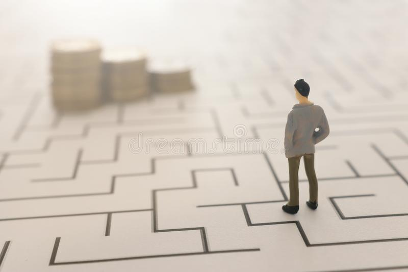 Business concept image of and challenge. A man stands in the maze looking for the exit. Problem solving and decision making idea.  stock photography