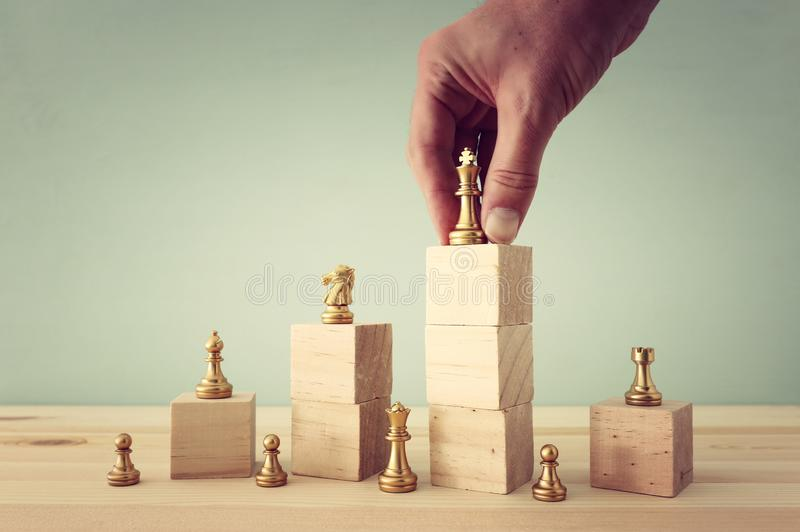 business concept image of chess figures over wooden table, human resources and management concept royalty free stock photography