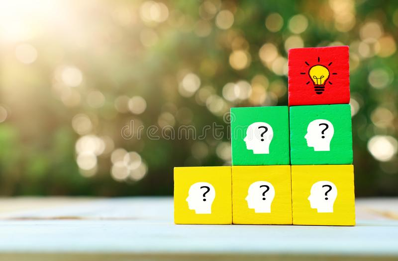 Business Concept image of revealing an idea, finding the right solution during creative process. Hand picking cube with bright. Light bulb royalty free stock photos
