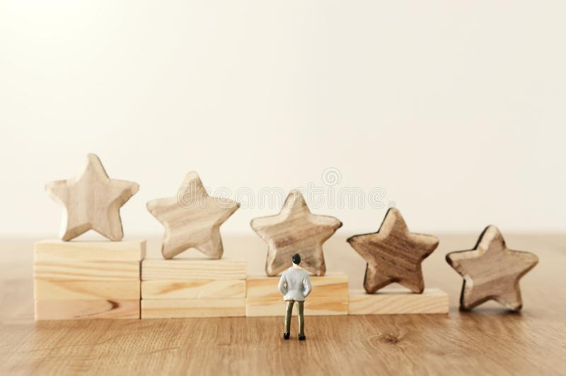 Business concept image of setting a five star goal. increase rating or ranking, evaluation and classification idea.  stock image