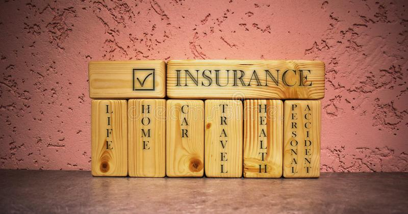 Business concept of insurance on wooden blocks royalty free stock photo