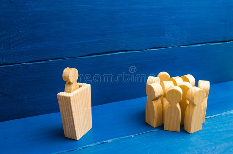 Business concept of leader and leadership qualities, crowd management, political debate and elections. Business management. The leader from the rostrum speaks royalty free stock photo