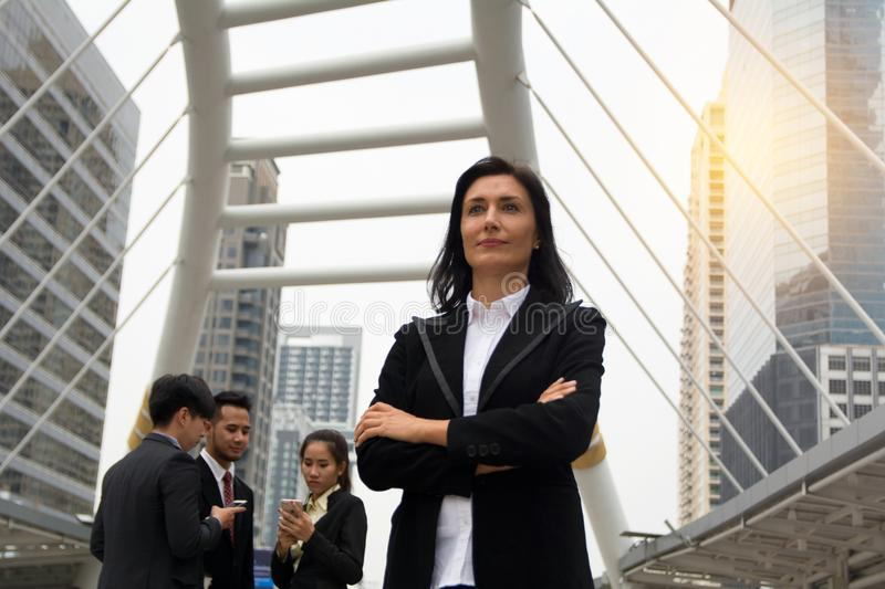Business concept - leader standing in front of team to lead team royalty free stock photo