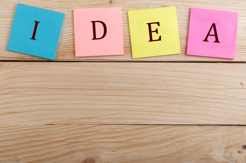 Business concept - Many colorful sticky note with text Idea. On wooden desk, management, achieve, achievement, success, action, goal, vision, plan, career royalty free stock photography