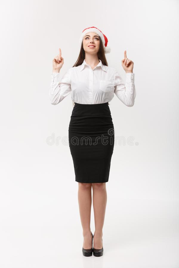 Business Concept - Modern caucasian business woman in the white studio background pointing finger upward presenting. Product royalty free stock photography