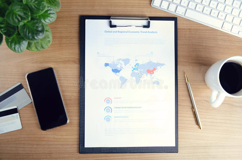Business concept of office desktop with financial report stock image