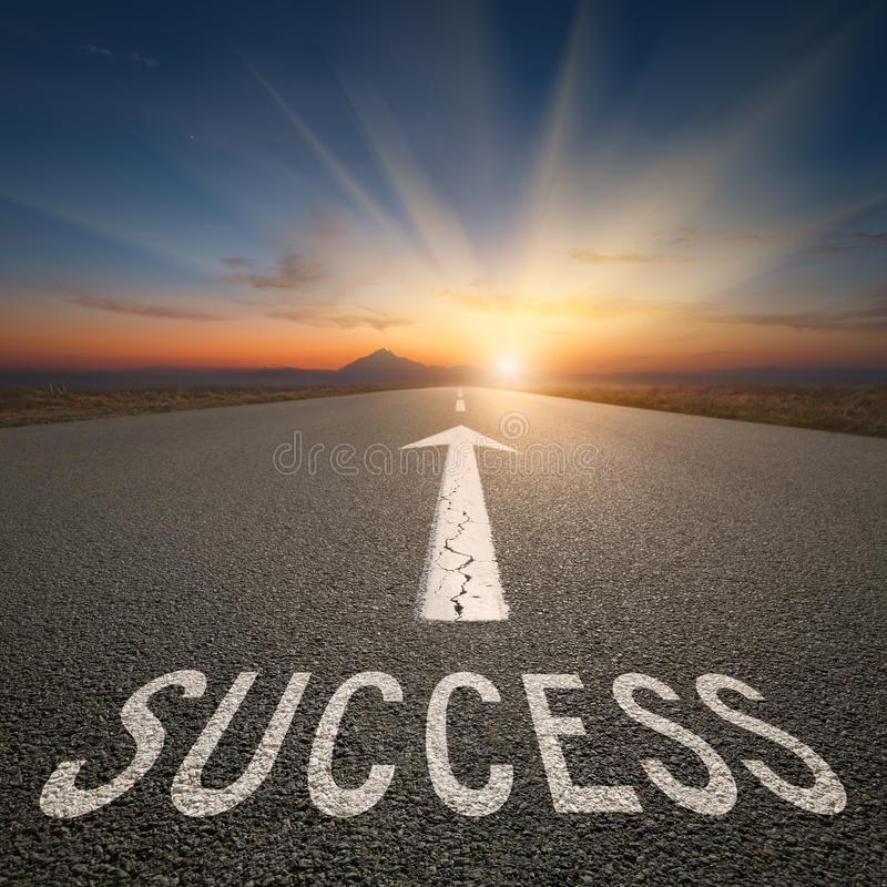 Business concept on an open road with success text royalty free stock photos
