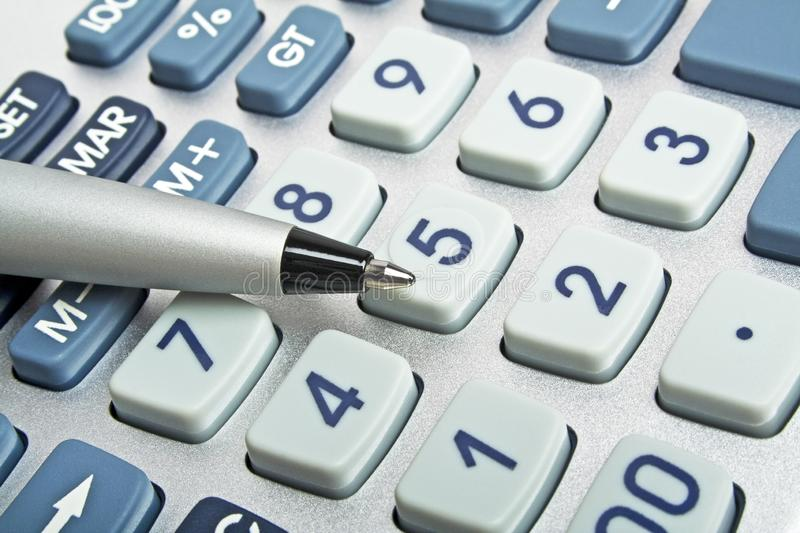 Business concept, pen and calculator keyboard. Front view royalty free stock photo
