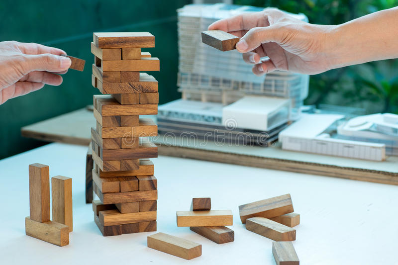 Business concept plan and risk project business team work. Image by Wood block tower with architecture model stock photo