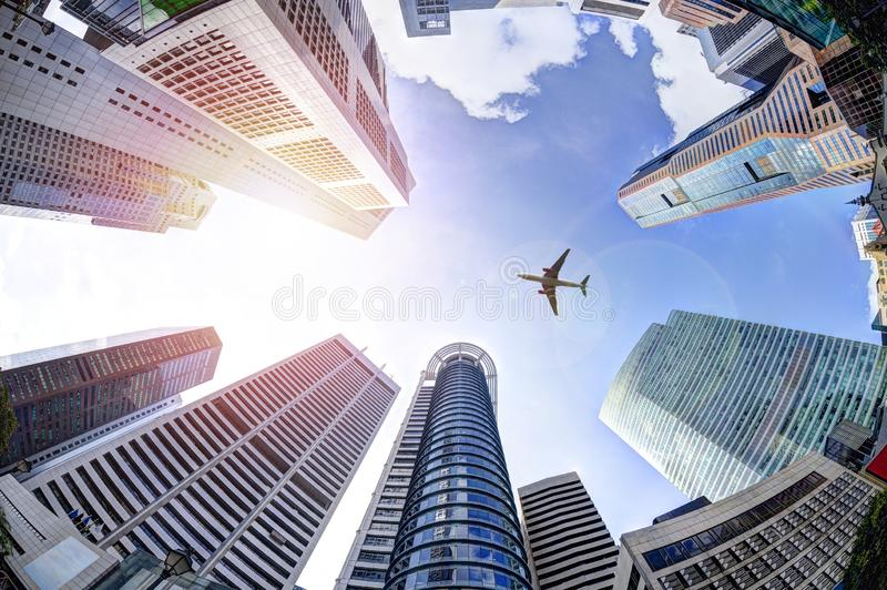 Business Concept With Plane Flying Over Modern Skyscrapers in Si stock photography