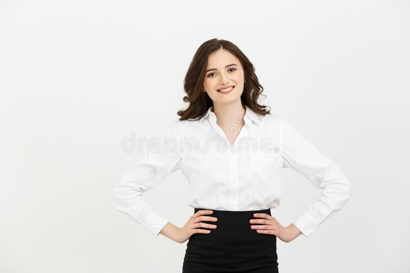 Business Concept: Portrait of Beautiful young business woman posing over white background. royalty free stock image