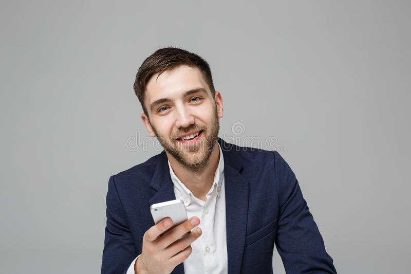 Business Concept - Portrait handsome happy handsome business man in suit playing moblie phone and smiling with laptop at work offi. Business Concept - Portrait royalty free stock photography