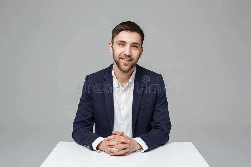 Business Concept - Portrait handsome happy handsome business man in suit smiling and siting in work office. White. Background royalty free stock photo