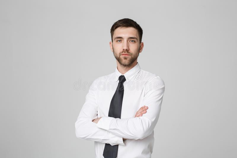 Business Concept - Portrait Handsome Business man crossing arms with confident face. White Background. Copy Space. royalty free stock photo